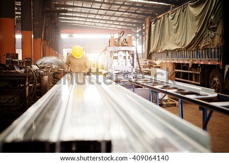 Steel factory assembly line, workers in the next molding equipment. - stock photo