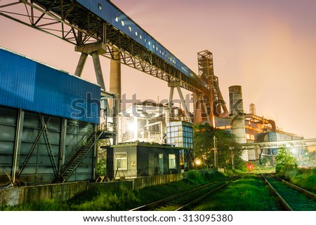Steel factory at dusk - stock photo
