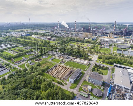Steel factory with smokestacks at suny day.Metallurgical plant. steelworks, iron works. Heavy industry in Europe.Air pollution from smokestacks, ecology problems. Industrial landscape.View from above - stock photo