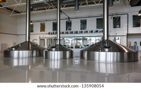 Steel fermentation vats on brewer factory - stock photo