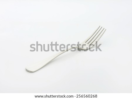 Steel fork on white background - stock photo