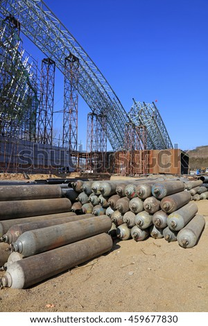 Steel frame and compressed gas cylinders in a construction site