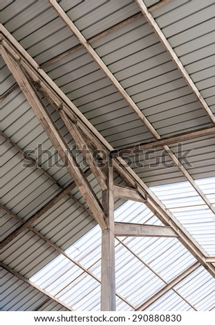 Steel frame of modern roof in factory park. - stock photo