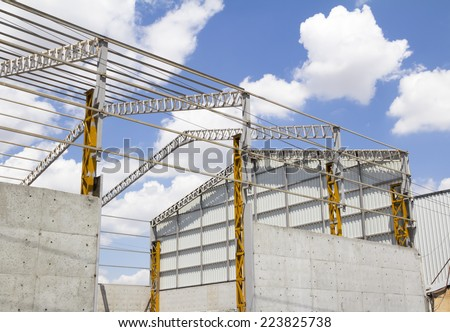 Steel frame structure building construction site - stock photo