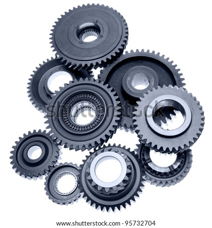 Steel gears meshing together - stock photo