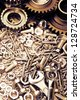 Steel gears, nuts, bolts, and wrenches - stock photo