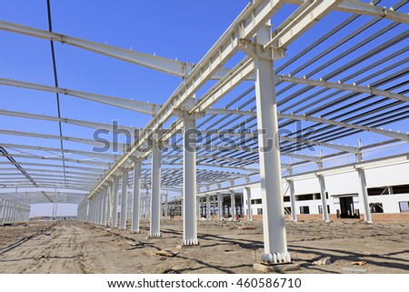 steel girder truss under blue sky, closeup of photo - stock photo