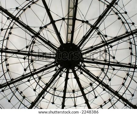 Steel girders forming the inside infrastructure of a white dome - stock photo