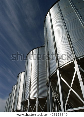Steel granary against blue sky - stock photo