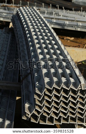 Steel grating and outdoor galvanized steel equipment at outdoor switch-gear site construction.