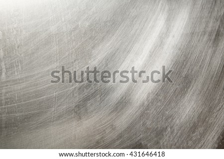 Steel grey scratchy background pattern in closeup - stock photo