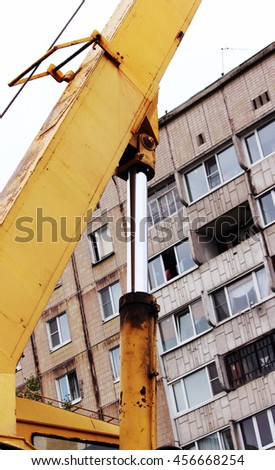 steel hydraulic piston to crane, which lifts and lowers the concrete slab during repair work.