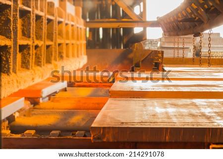 Steel industry,Slab is charging in Furnace. - stock photo