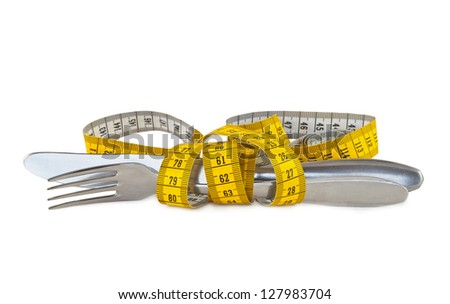 Steel knife and fork tied with measuring tape - stock photo