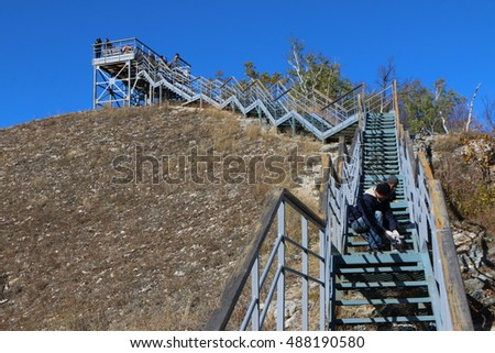 Steel ladder on the Strelnaya Mountain at the Zhiguli Nature Reserve against a blue sky