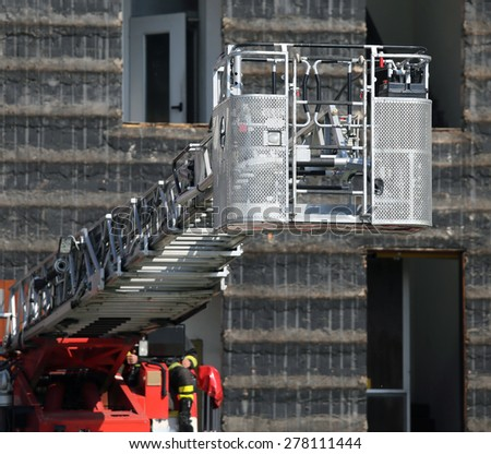 steel ladder rack of firefighters during exercise in the Firehouse - stock photo