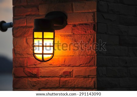 Steel light post in downtown - stock photo