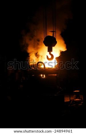 Steel making and crane hook - stock photo
