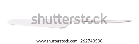 Steel metal cake server tool isolated over the white background - stock photo