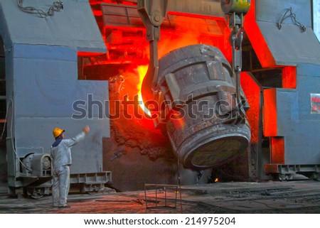steel mills converter filling materials, closeup of photo  - stock photo