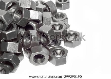 Steel nut pattern on white background. - stock photo