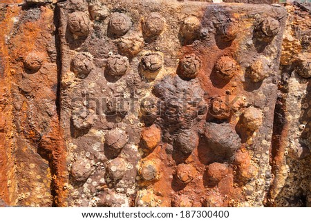 Steel panel from hull of shipwreck, the Maheno creates an abstract pattern in rust. - stock photo
