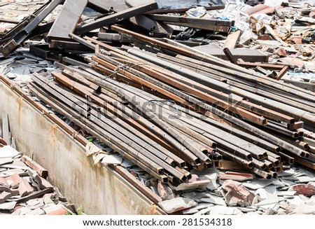Steel pile near the demolition site of old factory. - stock photo