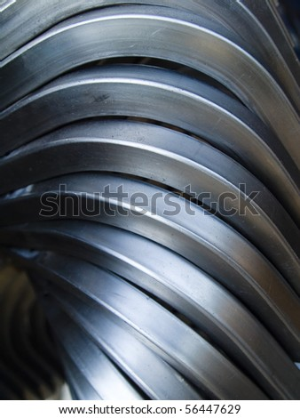 Steel Pipe bending forming for use in directors furniture - stock photo