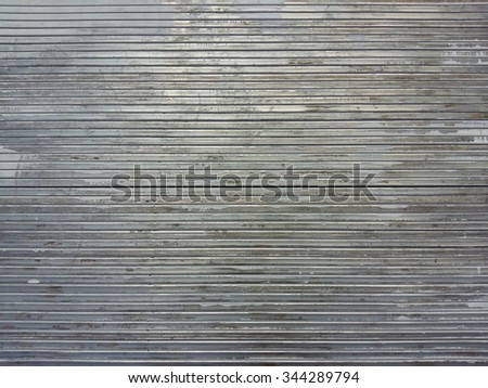 Steel pipe surface being painted. - stock photo