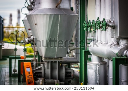 steel pipelines and rotary valve in factory - stock photo