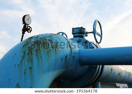Steel pipelines and valves against blue sky