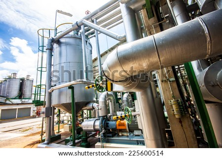 steel pipelines ,steam zone in factory - stock photo