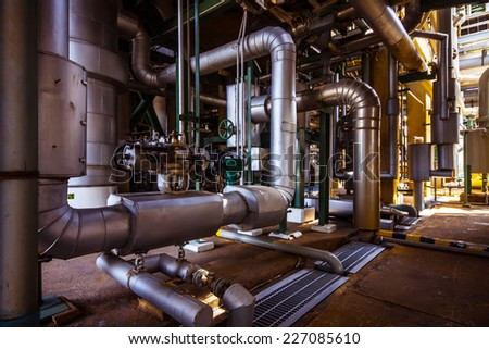 steel pipelines zone in factory - stock photo