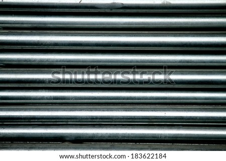 Steel pipes background & texture - stock photo