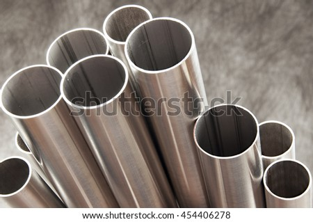 steel pipes on grey background - stock photo