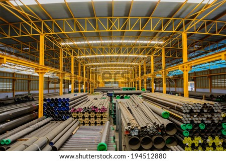 Steel pipes storage in warehouse - stock photo