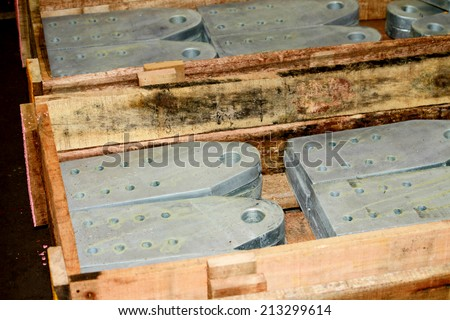 Steel plate bunch in the wooden pallet in wartehouse - stock photo