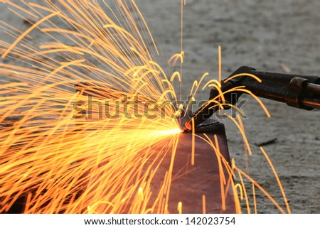 Steel plate cutting by gas machine - stock photo
