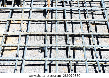 Steel rebar for reinforced concrete at the job site. - stock photo