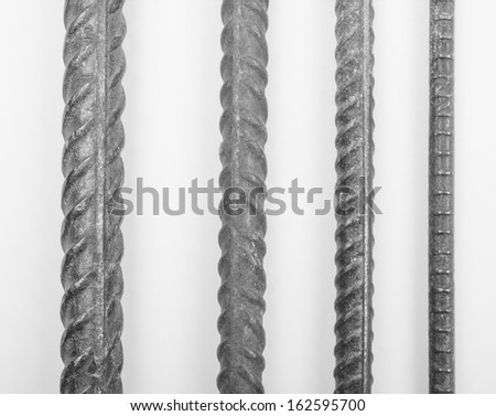 Steel reinforcing bars in different sizes for reinforced concrete construction in black and white - stock photo