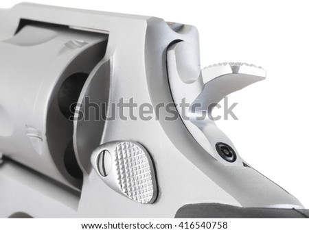 Steel revolver with its hammer down isolated on white