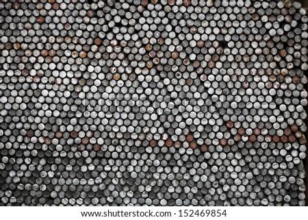Steel rod bunch in warehouse - stock photo