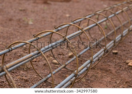 steel rod for poles construction at construction site - stock photo