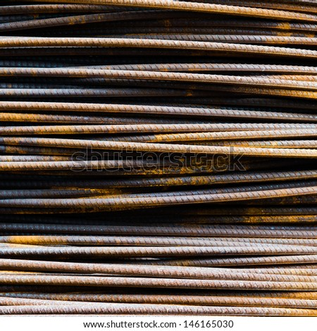 Steel rods or bars used to reinforce concrete.