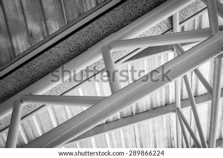 steel roof truss with zinc gutter and roof insulation, black and white - stock photo