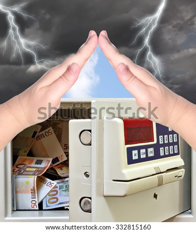 Steel safe with money and hand protection gesture against the storm weather. Concept of a Reliable protection and security  - stock photo