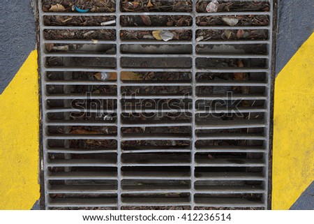 Steel sewer cover or manhole cover.  - stock photo