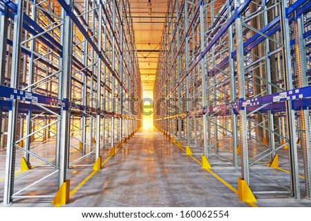 steel shelves rack in new modern large warehouse - stock photo