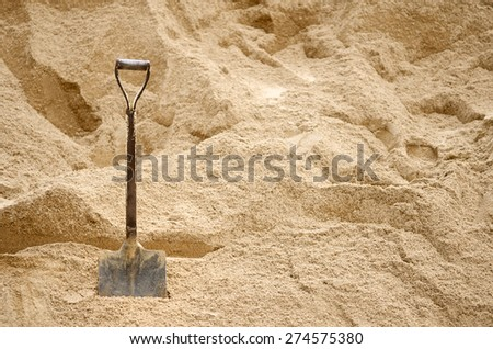 Steel shovel be used for scoop sand to construct the building - stock photo