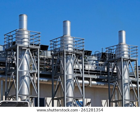 Steel smoke stacks of the power station - stock photo